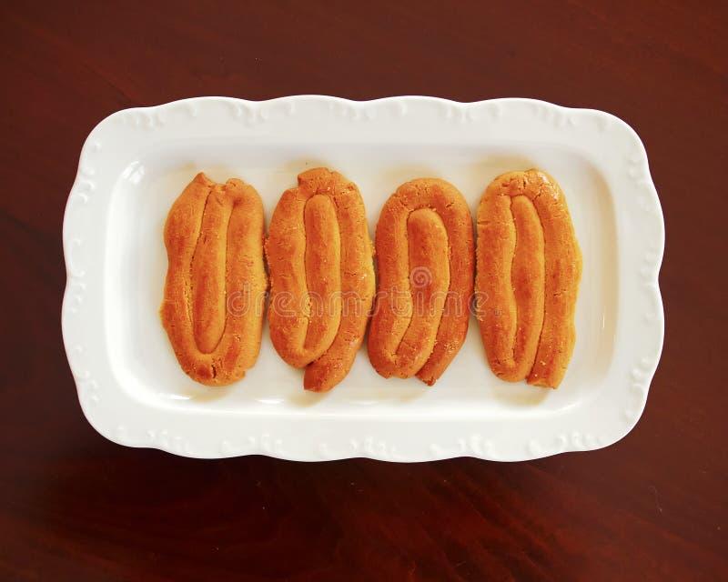 `Smirneika` Greek Easter cookies. Smirneika homemade Greek Easter cookies, served royalty free stock photography