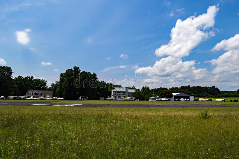 Smith Mountain Lake Airport. Huddleston, VA – July 2nd: A ground view of Smith Mountain Lake Airport on a beautiful summer's day located in royalty free stock photo