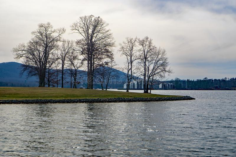 Smith Mountain Lake, Virginia, USA. Smith Mountain Lake with Smith Mountain and condominiums in the background located in Bedford County, Virginia, USA royalty free stock image