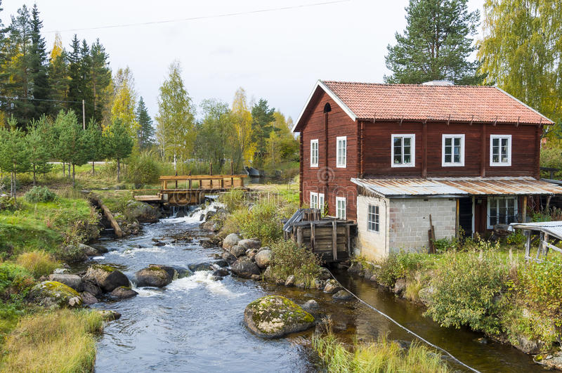 Smithy at small river Sweden. Old smithy in timber building with water tube at the small river Karan (Swedish: Kårån) in Karbole (Swedish: Kårböle) royalty free stock photos