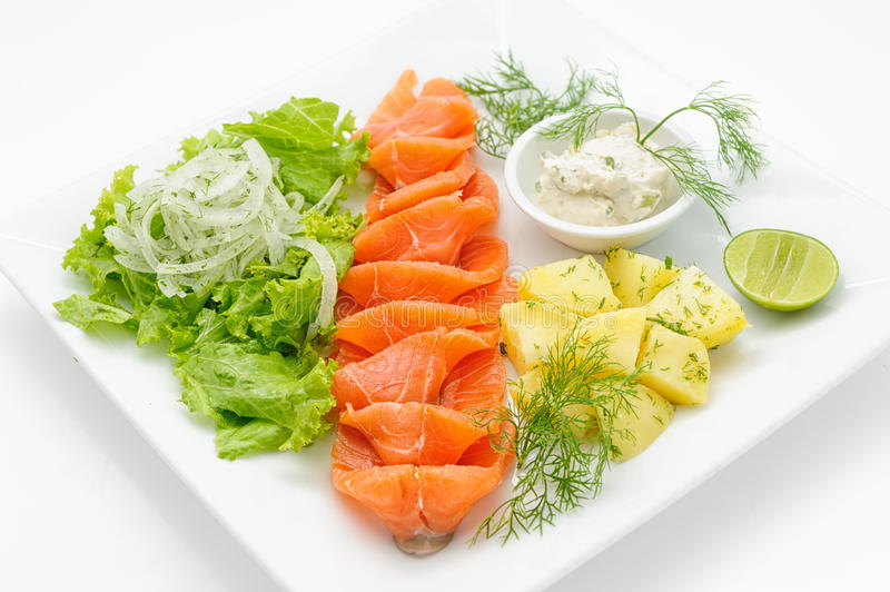 Smocked salmon with mayonnaise and boiled potatoes stock photo