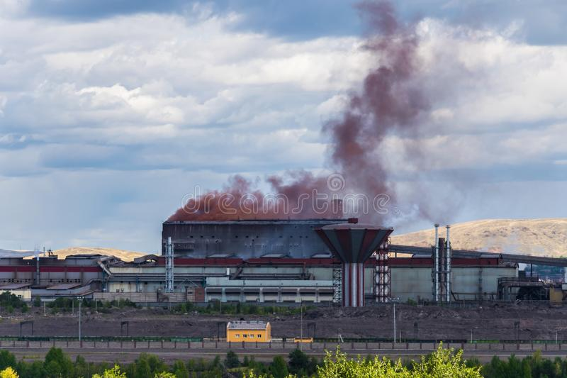 Smog from the metallurgical plant. Colored and acrid smog from the steel mill royalty free stock photography