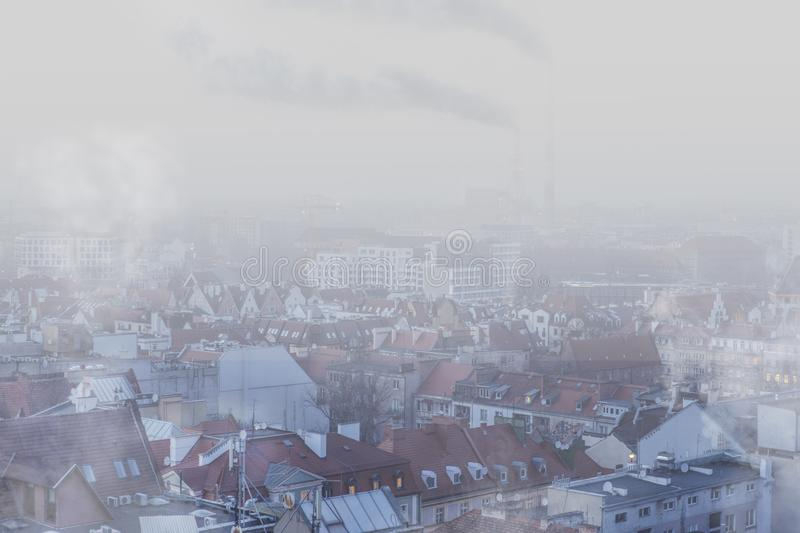 Smog over the city of Wrocław, Poland. Winter view of the city skyline royalty free stock photos