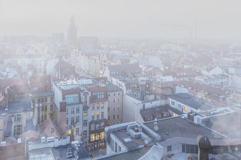 Smog over the city of Wrocław, Poland. Winter view of the city skyline stock images