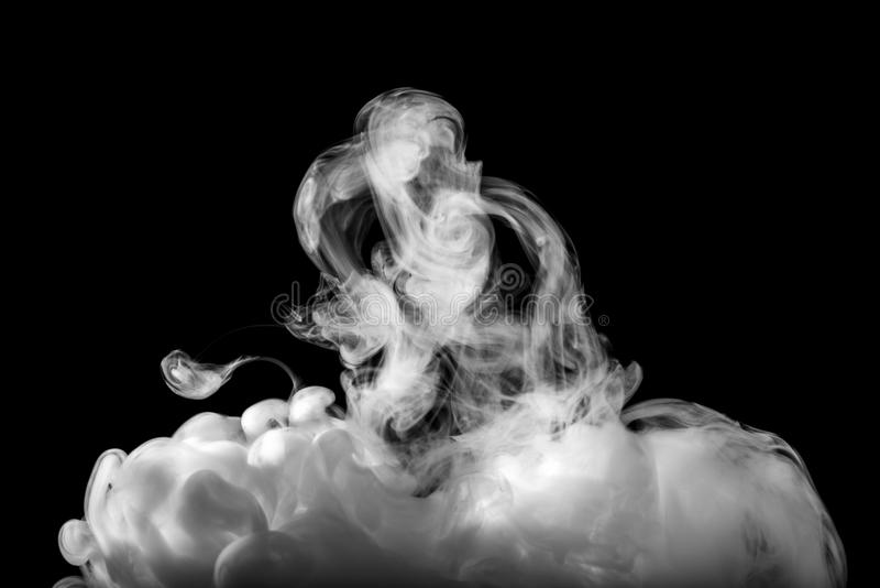 Smoke abstract. Abstract White smoke on a black background royalty free stock photo