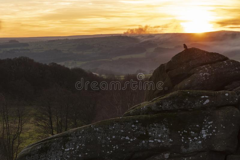 Brimham Sunset. With smoke in the air the sun is setting over the Pennines near Pateley Bridge close to Brimham Rocks royalty free stock photo