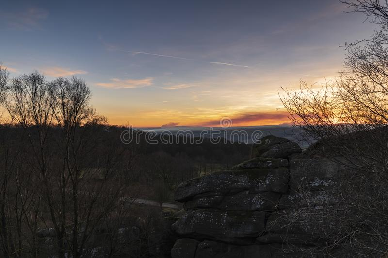 Brimham Sunset. With smoke in the air the sun is setting over the Pennines near Pateley Bridge close to Brimham Rocks royalty free stock photos