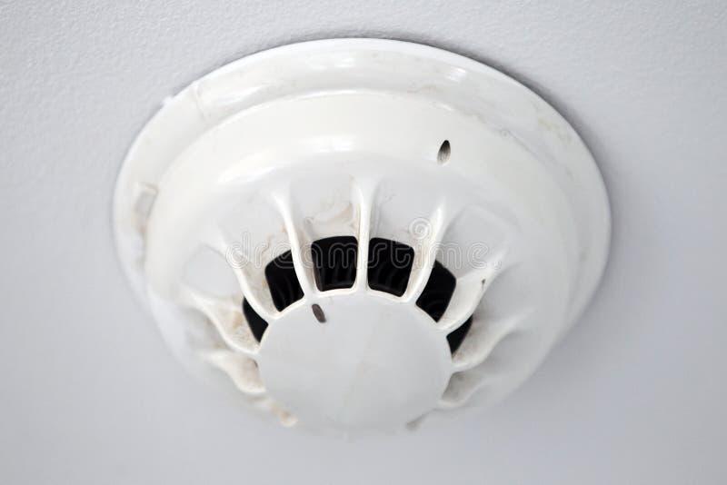 Smoke alarm. A ceiling mounted smoke alarm stock images