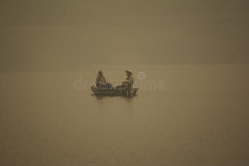 Smoke From The BC Fires Settles Around Fishermen royalty free stock photos