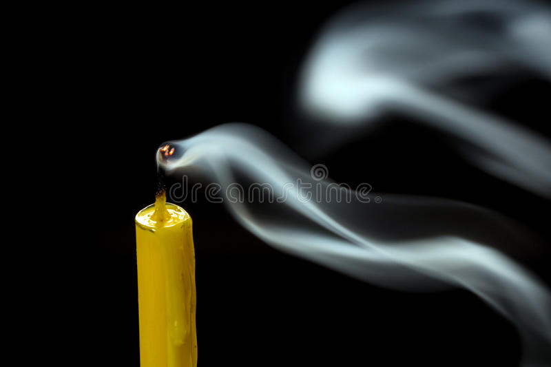 Smoke when the candle goes out. White smoke when the candle goes out royalty free stock photos