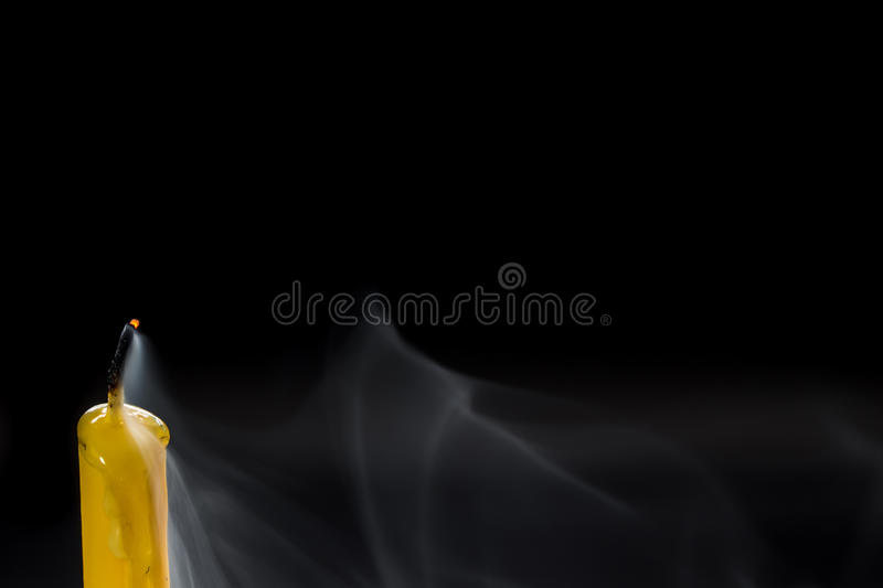 Smoke when the candle goes out. White smoke when the candle goes out royalty free stock image