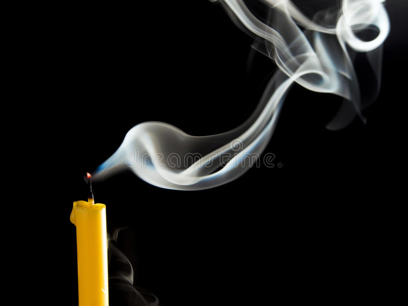 Smoke when the candle goes out. White smoke when the candle goes out stock images