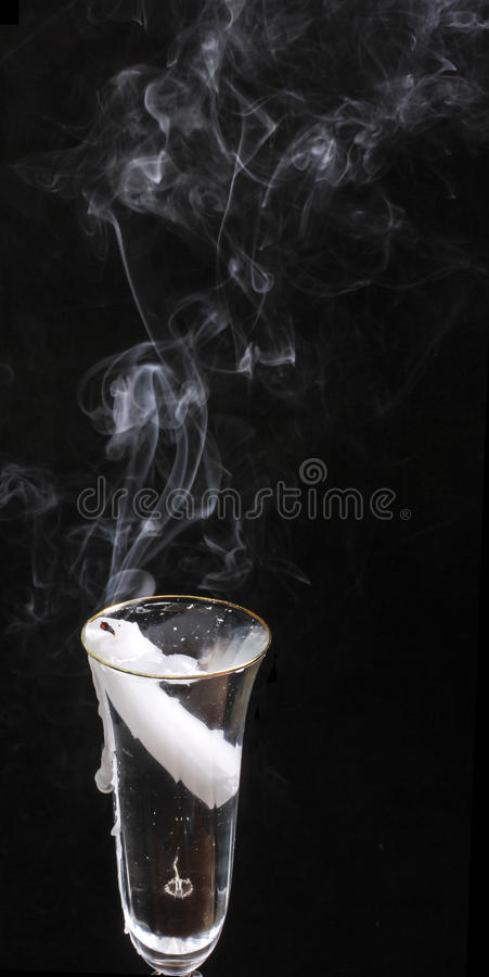Download The Smoke From Candle,which Is Set In A Glass Of Clear Liquid Stock Image - Image: 83711527