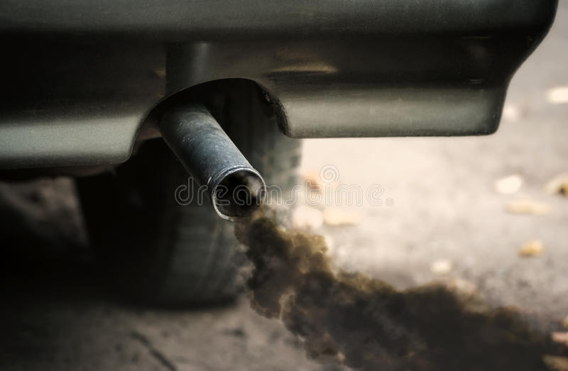 Smoke from car pipe exhaust royalty free stock photos
