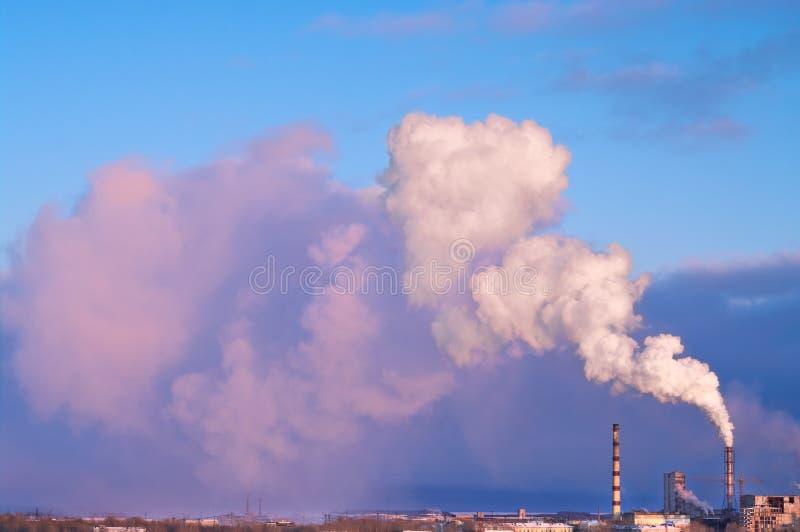 Smoke from chimney under city stock photography