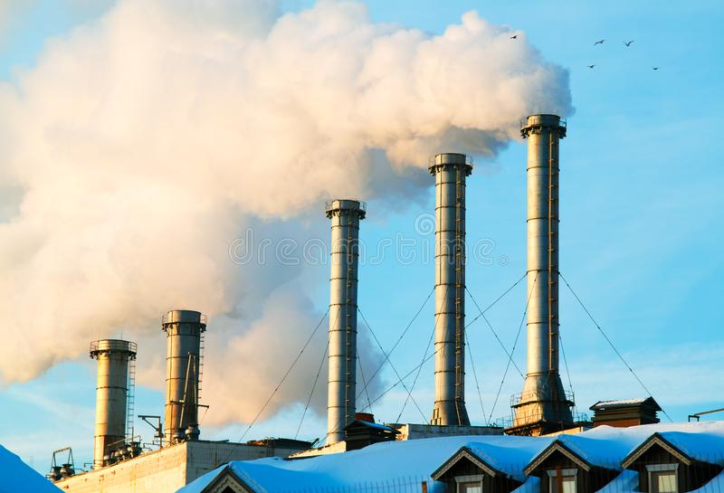 Smoke from chimneys poison atmosphere closeup background royalty free stock image