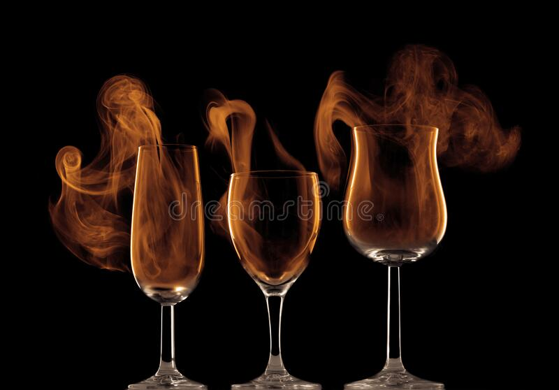 Smoke coming out of wine glasses royalty free stock photography