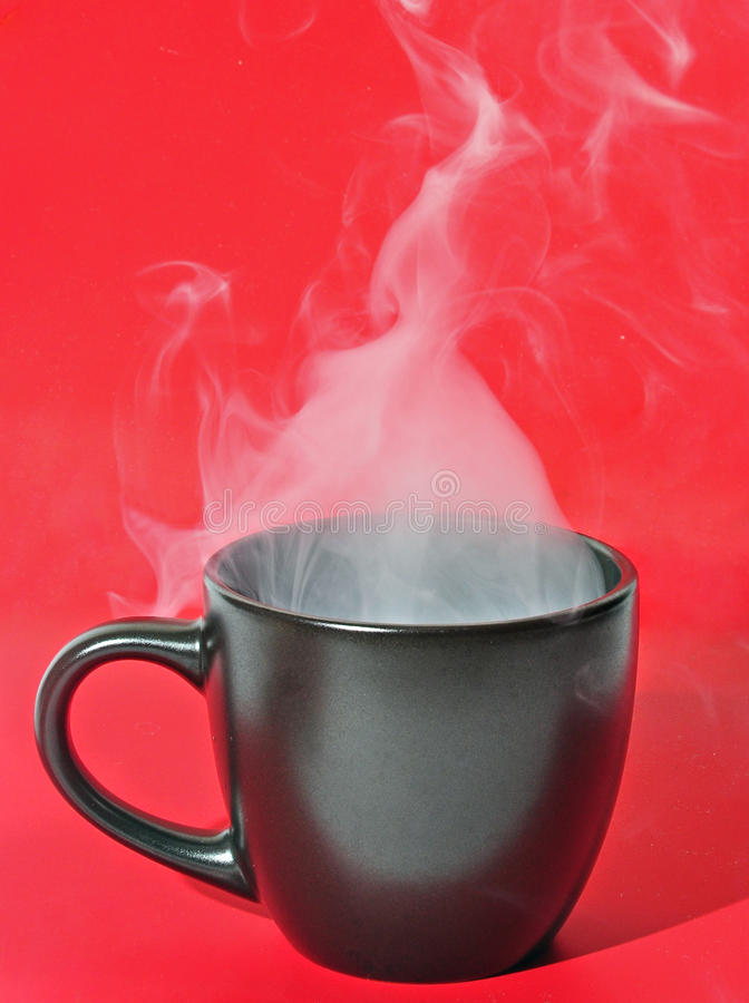 Smoke cup. A black cup with smoke on a red background royalty free stock photos