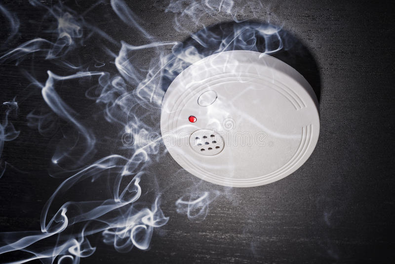 Smoke Detector. In the smoke of a fire royalty free stock photography