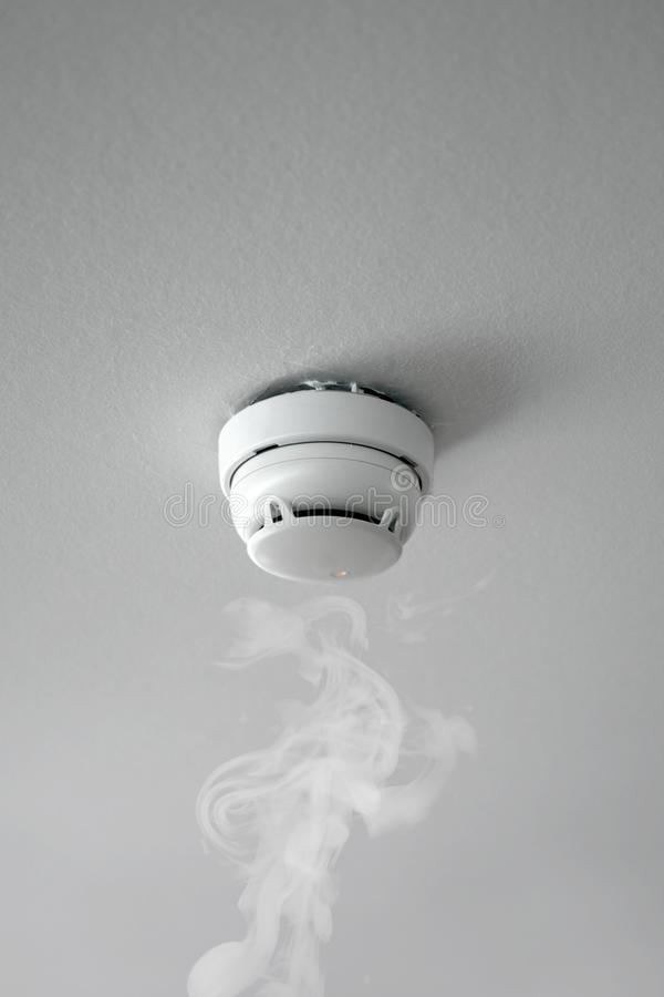Smoke detector of fire alarm in action royalty free stock photo