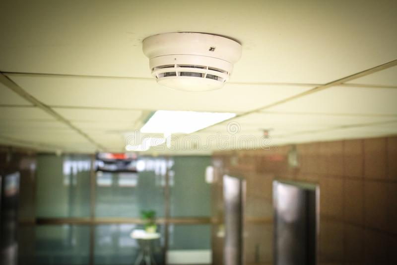 Smoke detectors. Under the ceiling of the building royalty free stock photos