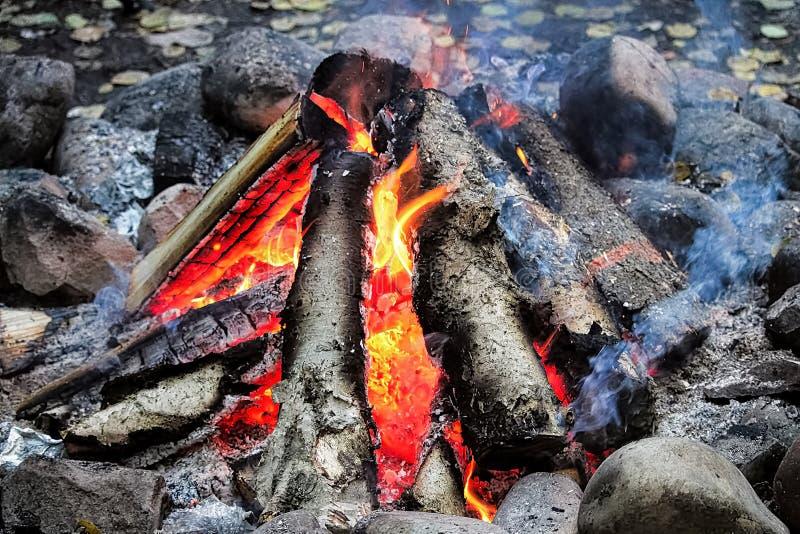 Smoke drifting out of a tepee campfire stock photo