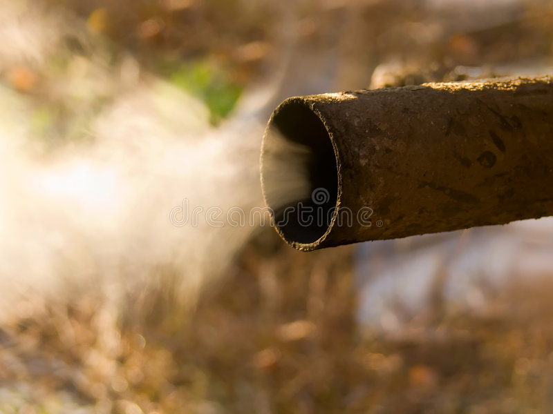 Smoke emission. Emission of gases from an exhaust pipe of the car stock photography