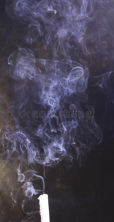 Download The Smoke From An Extinguished Candle Fills The Room On A Dark Background Stock Image - Image of candle, contrast: 83711369