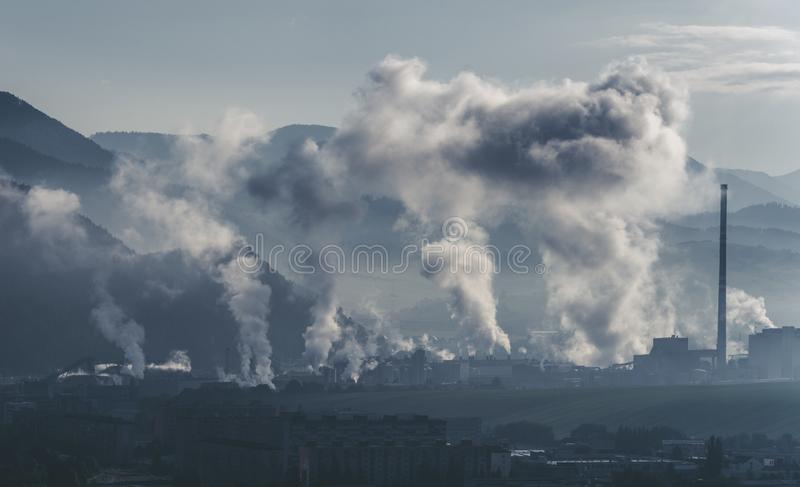 Smoke from the factory in city royalty free stock images