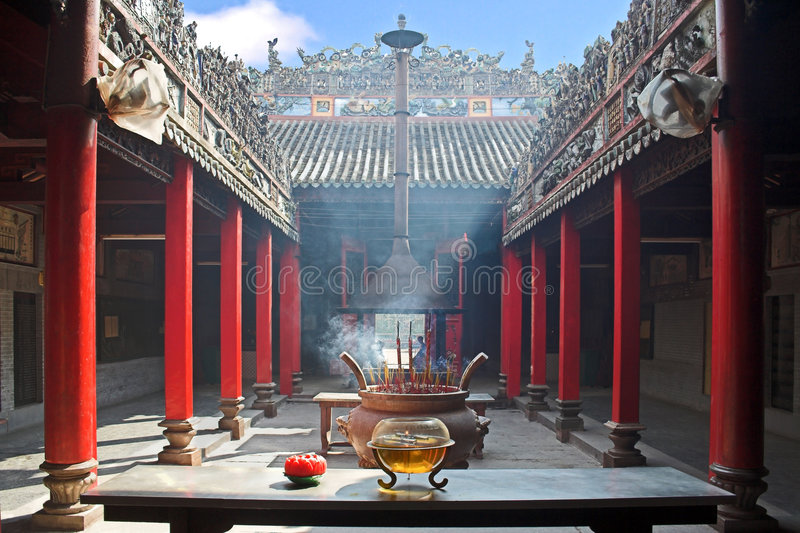 Smoke-filled temple. Temple filled with smoke from burning incenses