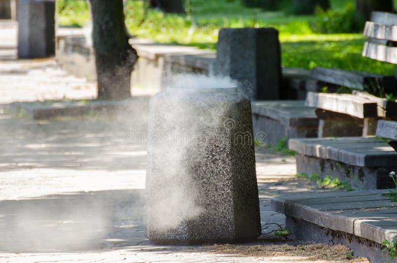 Smoke from Garbage bin. Smoke from firing trash container. Smoke from Garbage bin stock photography