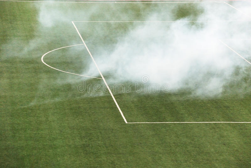 Smoke on the football field. In penalty area stock photo