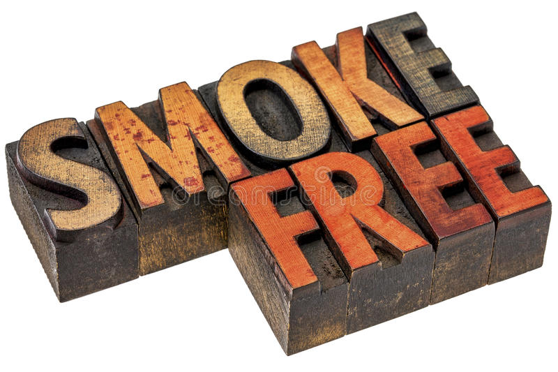 Smoke free abstract in letterpress wood type. Smoke free word abstract - an isolated banner in vintage letterpress wood type stained by color inks royalty free stock photography