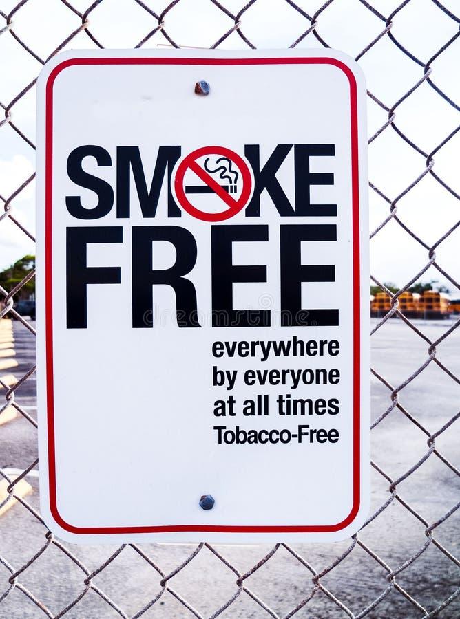 Smoke Free Non Smoking Metal Sign Hanging on a Fence. Non Smoking Sign for a Smoke Free Protected Area stock photography