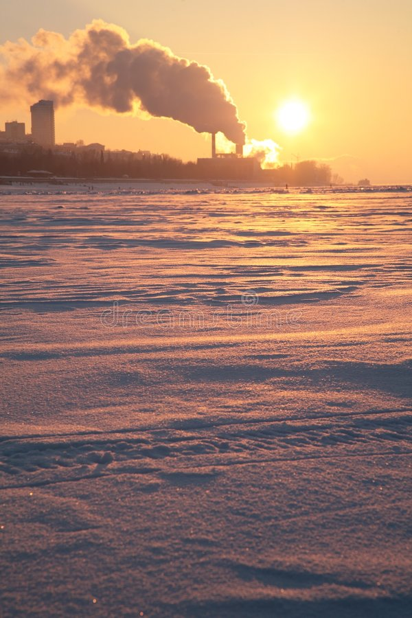 Free Smoke From Pipes Above Frozen River 2 Stock Image - 4485271