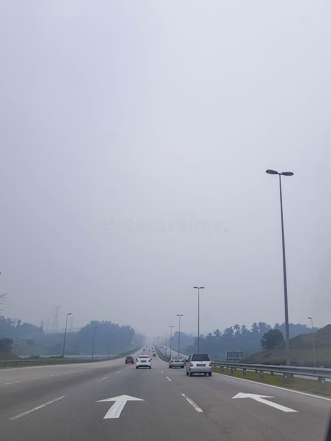 Smoke haze shrouds Kuala Lumpur highway as the result of forest burning in Indonesia. KUALA LUMPUR, MALAYSIA - SEPTEMBER 20, 2019: Smoke haze shrouds Kuala stock image