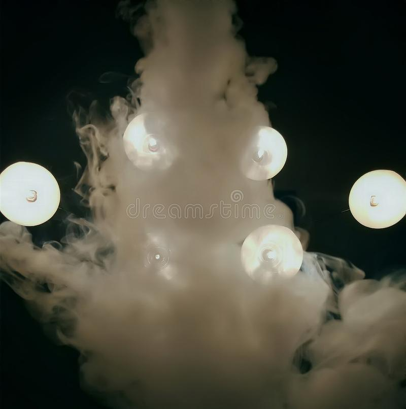 The smoke of the hookah. Shisha in the lights of lamps makes an image of an angry spirit or the ghost royalty free stock images