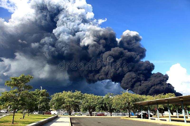 Smoke I. Smoke from a blast and fire at a fuel storage complex in Puerto Rico (CAPECO royalty free stock photography
