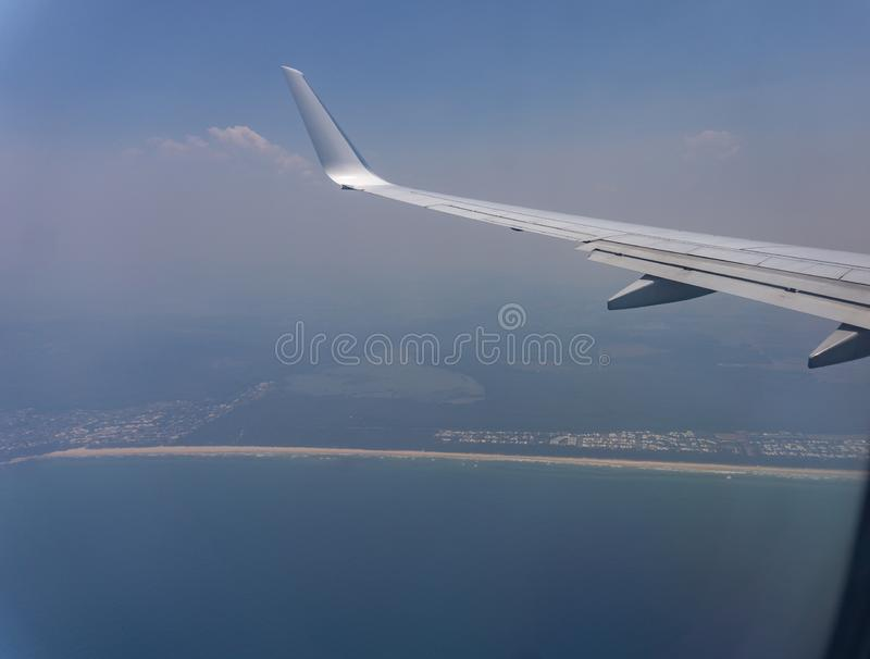 Smoke laden atmosphere coming into the Gold Coast, Australia. Smoke laden atmosphere beyond plane wing during November fires in Austraian bush.coming into the royalty free stock photo