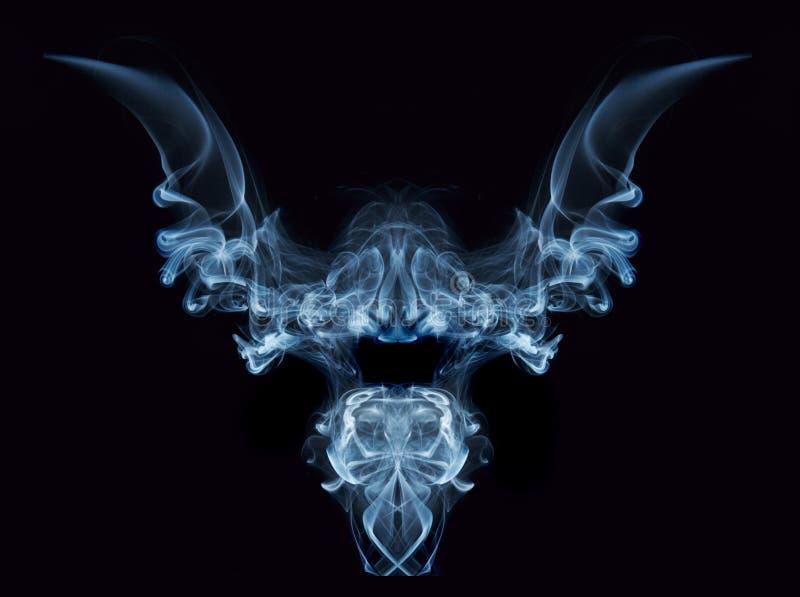 Smoke monster. Mirrored white smoke wisps (real smoke) combined into a scary monster-like figure stock image