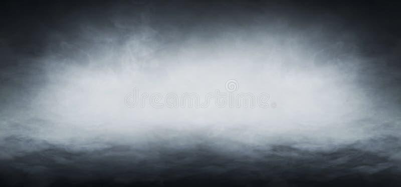 Smoke over black background stock photography
