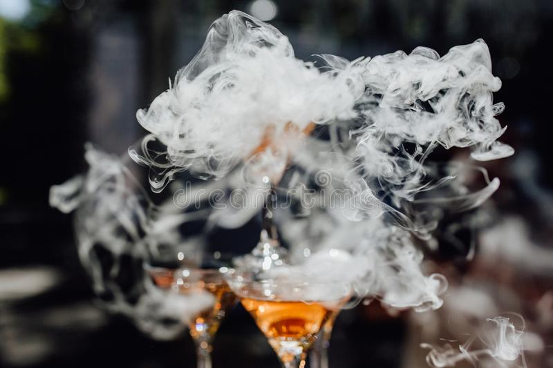 Smoke Over Martini Cocktail Glass Dry Ice Vapor royalty free stock photos