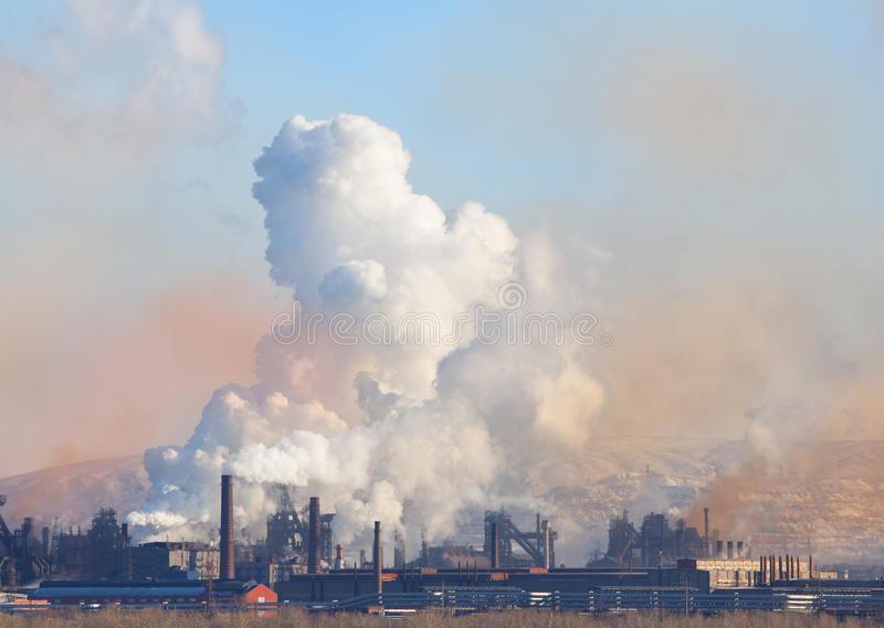 Smoke pipe. Metallurgical factory. Metallurgical factory. Environmental contamination. Smoke pipe stock image