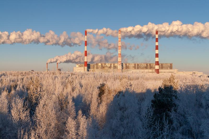 Smoke from the pipes of thermal power plants on the background of pure winter nature stock photo