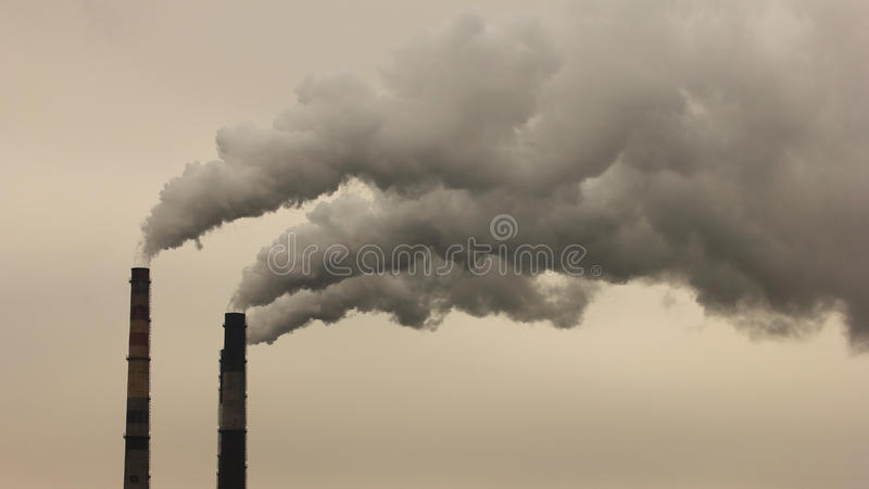 Smoke from the pipes royalty free stock photo