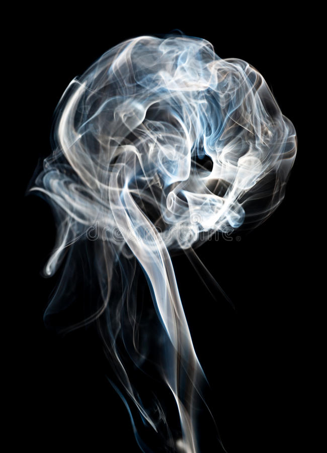 Smoke plume. A plume of backlit cigeratte smoke against a black background royalty free stock photos