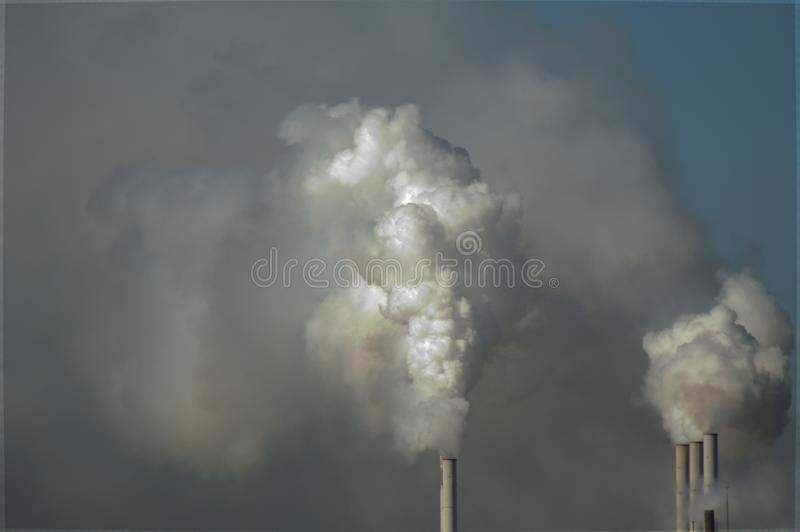 Smoke plume from chimney. Big smoke plume from chimney, drying corn plant stock images