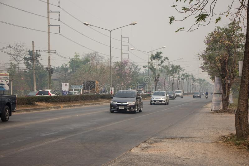 Smoke and Pollution Haze on highway road stock photos