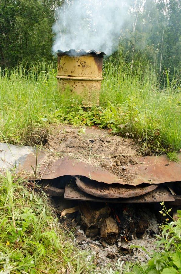 Smoke rises old barrel smokehouse firewood burn royalty free stock photo