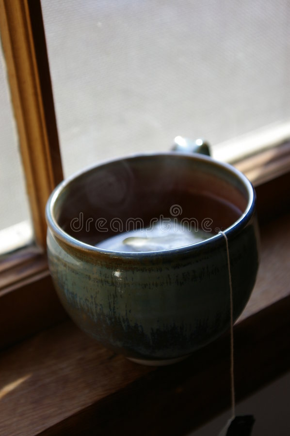 Free Smoke Rising Above A Tea Cup Stock Images - 580404
